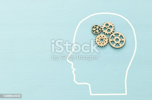 istock Brain order made from wooden cogwheels into human head. Concept of thinking, workflow, adhd and learning. 1096804532