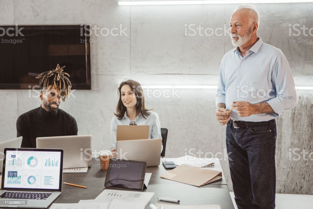 Coworkers in office have presentation at work