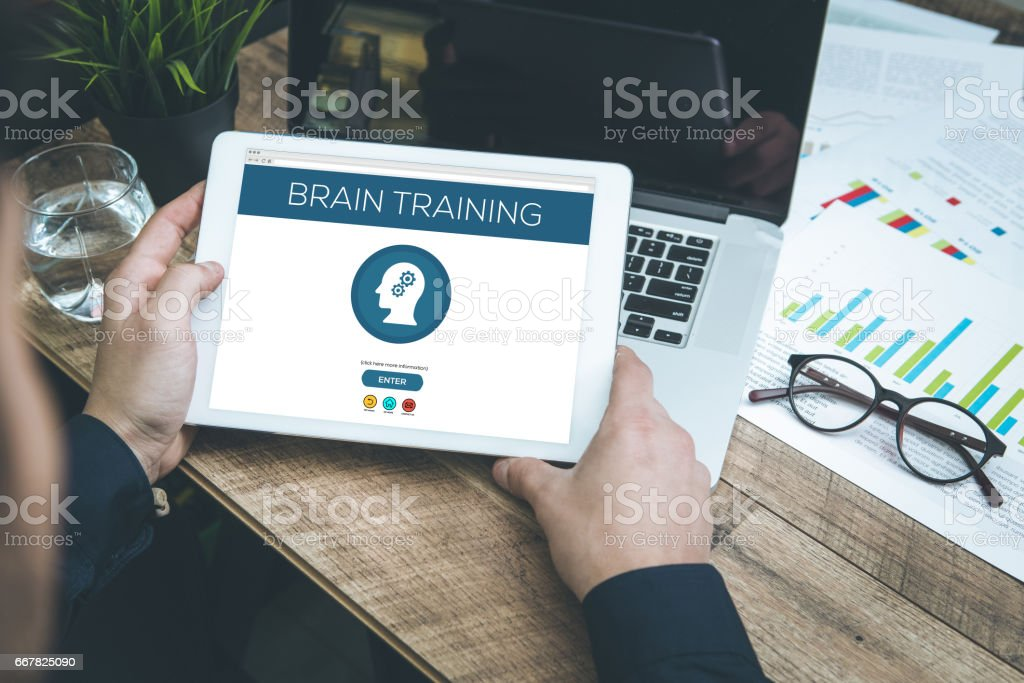 Brain Training concept on tablet pc screen stock photo