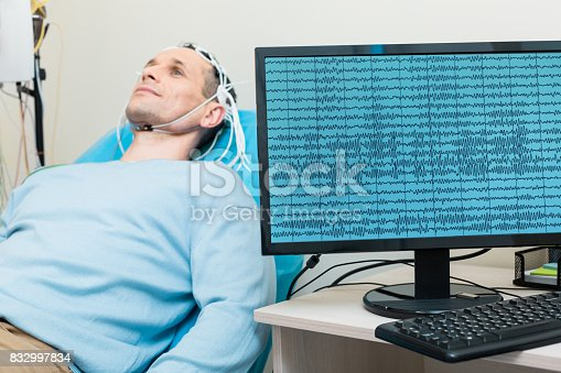 istock Brain waves of young man being displayed on screen 832997834
