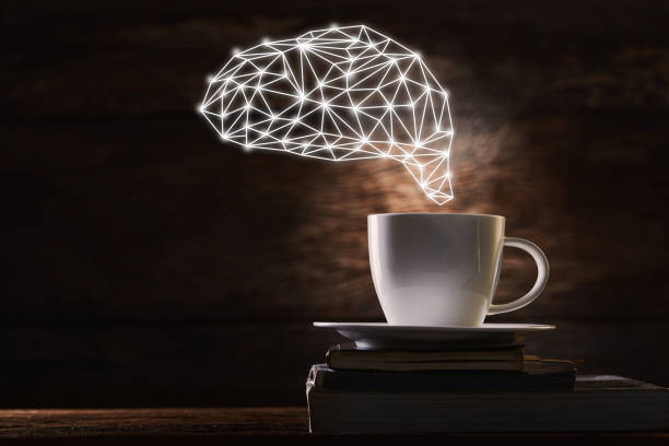 Brain with coffee cup stock photo
