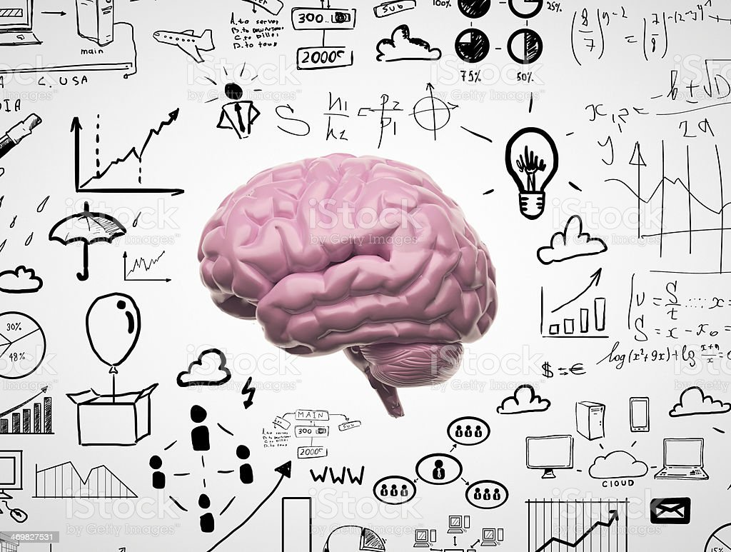 Brain with drawings around it stock photo