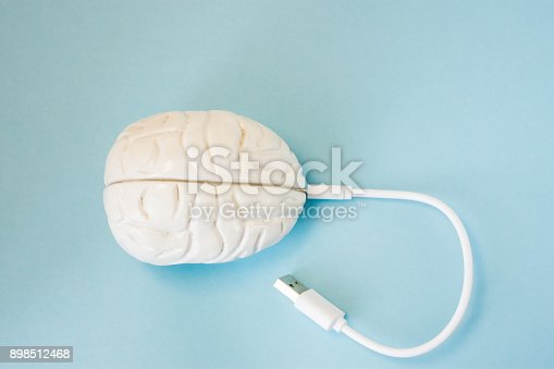 istock Brain with inserted in socket plug wire or charging cord. Concept technology wired transmission of data, information, knowledge in brain nervous system, mental or psychic connection or charging brain 898512468