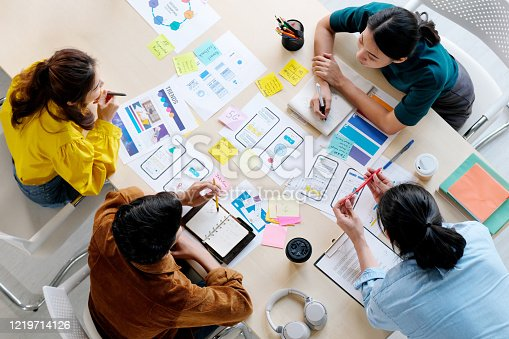 istock Brainstorm planing creative asian teamwork,  Group of asia mobile phone app developer team meeting for share ideas about screen display prototype layout for smartphone, ui, ux startup small business, top view 1219714126