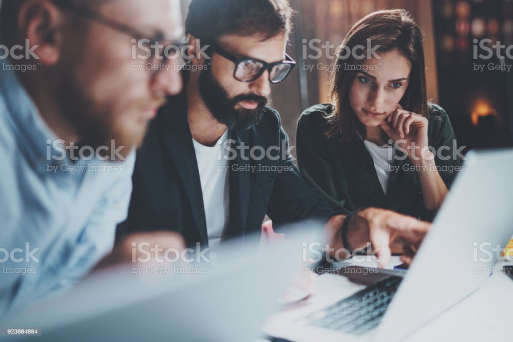 Brainstorming process at office.Young coworkers work together modern office studio.Horizontal.Blurred background.Cropped. stock photo