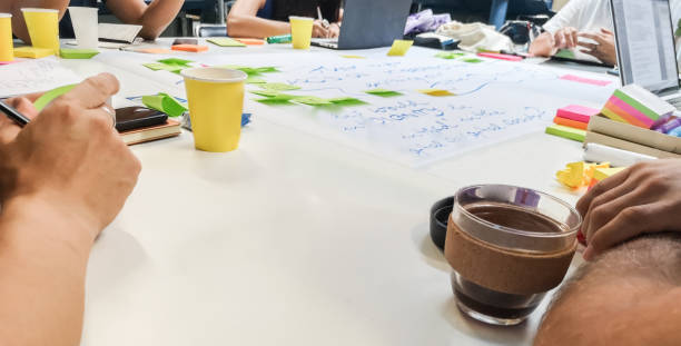 Brainstorming session with sticky notes on table stock photo