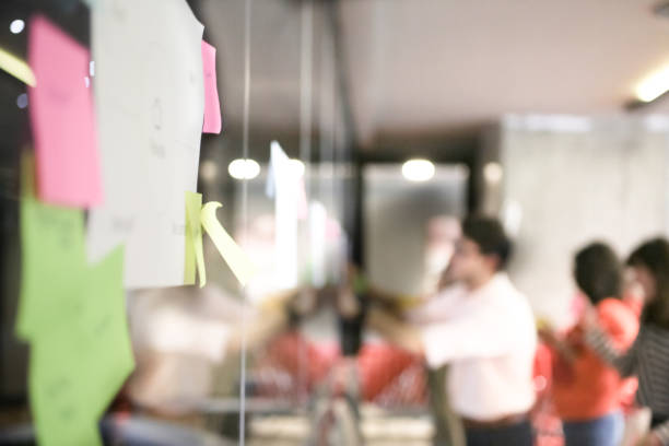 Brainstorming session with sticky notes on wall stock photo