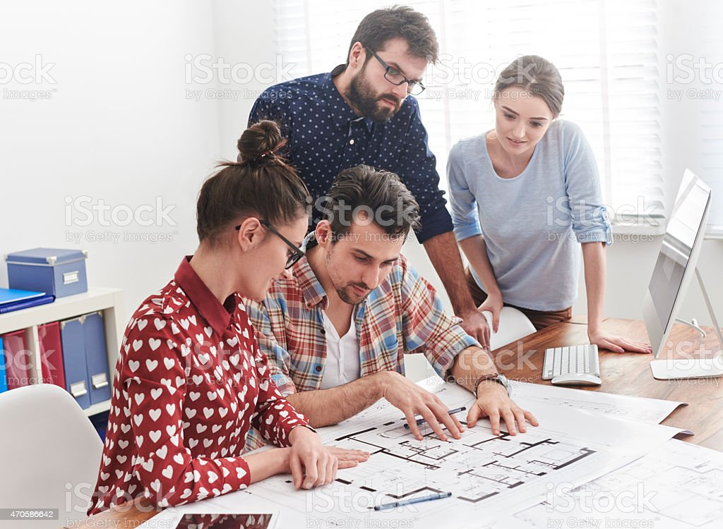 Brainstorming with coworkers at the office stock photo