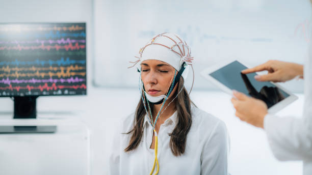 Brainwave EEG or Electroencephalograph Examination of the Brain in a Clinic Brainwave EEG or Electroencephalograph Examination in a Clinic neuroscience patient stock pictures, royalty-free photos & images