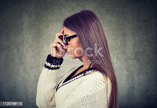 istock Brainy young woman in contemplation 1125799110
