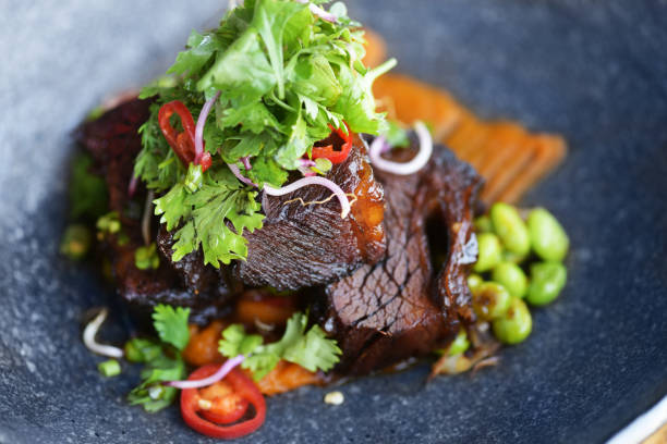 braised beef cheeks - braised stock pictures, royalty-free photos & images