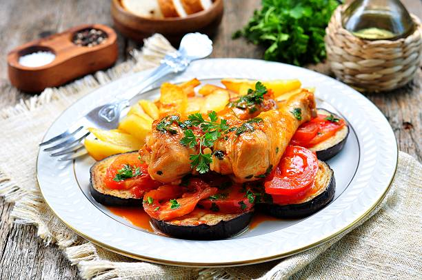 Braised chicken in white wine with eggplant, tomato stock photo