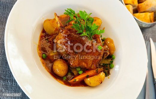 French cuisine, braised duck leg served with stewed vegetables