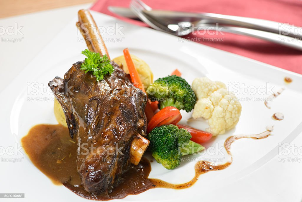 Braised lamb shank in restaurant stock photo