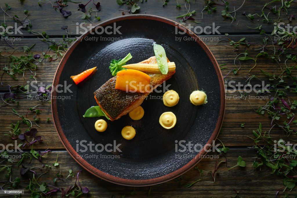 Braised Norwegian salmon with curry stock photo