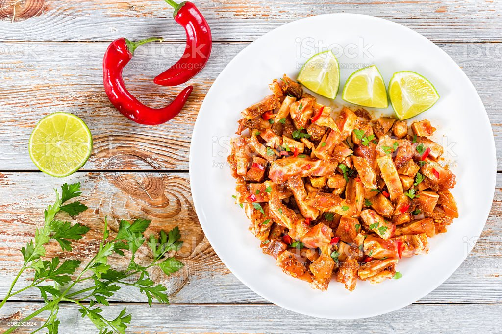 Braised Pig Ears with spices, chili pepper, pieces of lime foto royalty-free