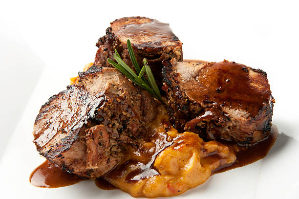 braised pork tenderloins - mash food state stock photos and pictures