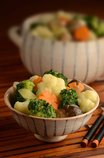Braised Straw Mushroom with Broccoli and Cauliflower stock photo