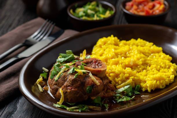 Braised veal shank, ossobuco, served with risotto and gremolata. stock photo