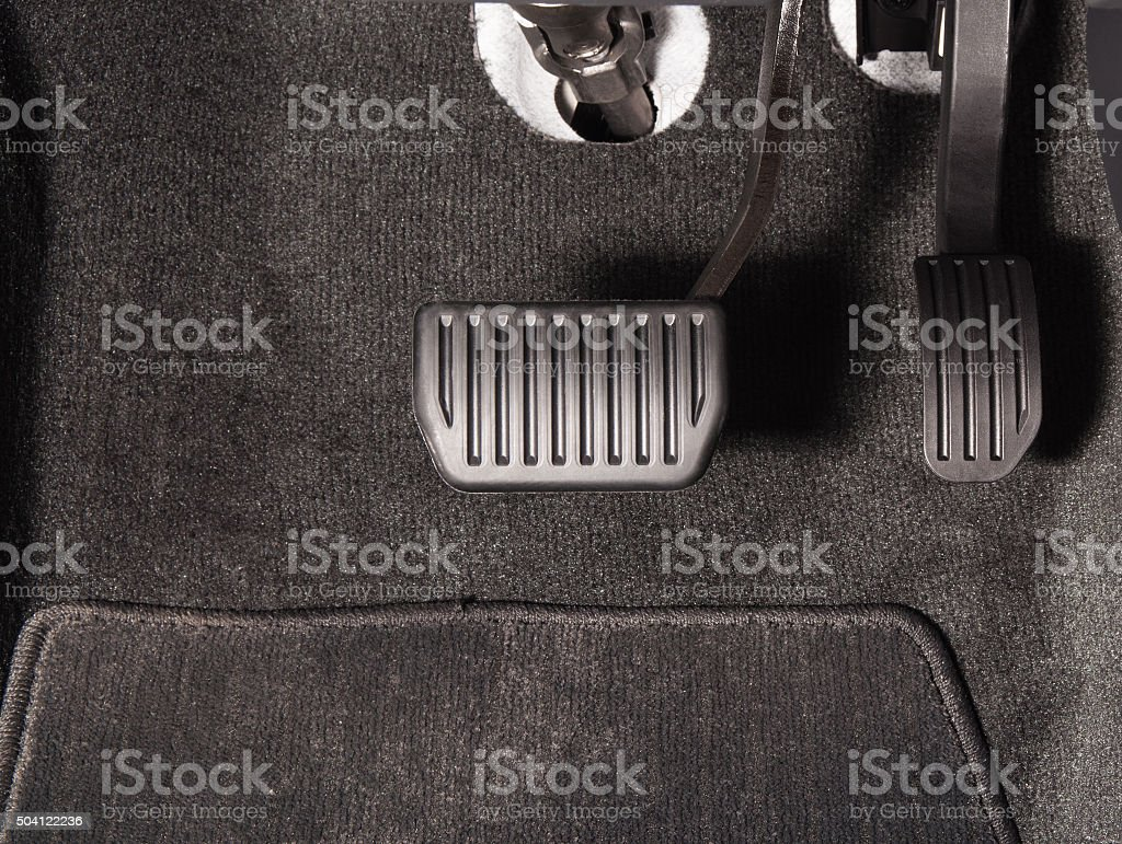 Brake and accelerator pedal stock photo