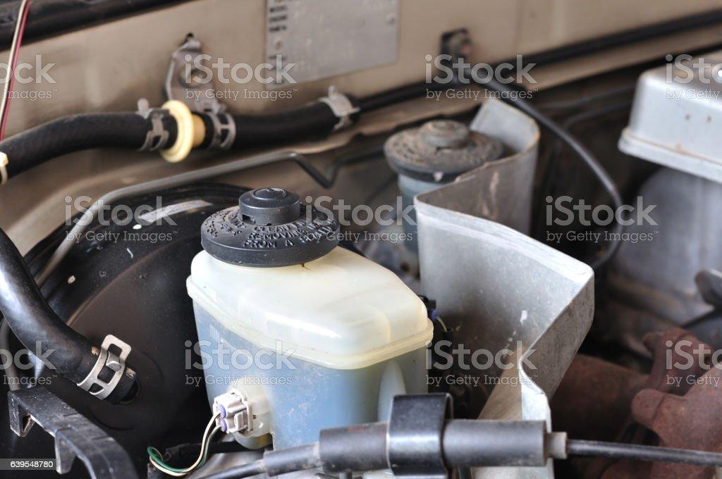 Brake and gear fluid bottle in engine room, maintenance. stock photo