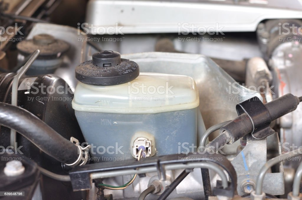 Brake and gear fluid bottle in engine room, maintenance. stock photo