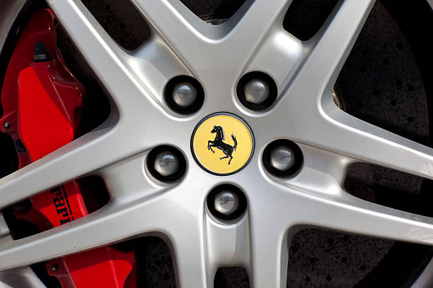 brake disc and alloy of a ferrari - badge logo stock photos and pictures