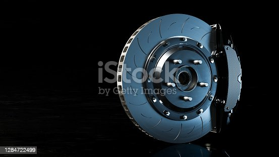 Brake Disc and Black Calliper on Looks like the road is wet and dark background. Brake from Racing car with Clipping path and copy space for your text. 3D Render.