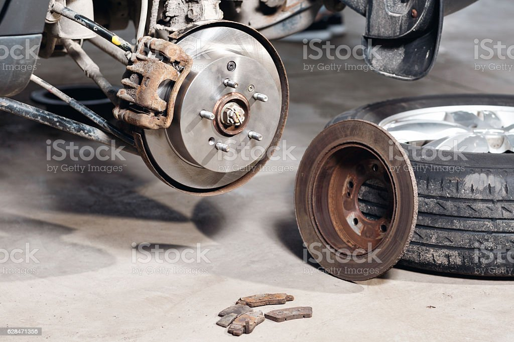 brake disc. Replacement of the old to the new. Auto stock photo