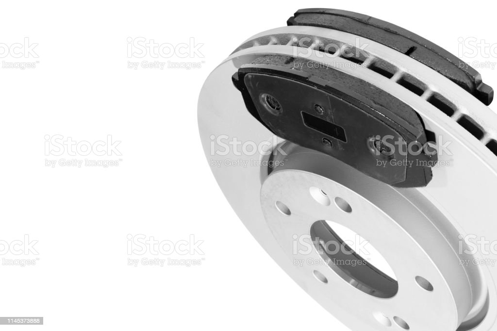 Brake Discs And Brake Pads Isolated On White Background Auto