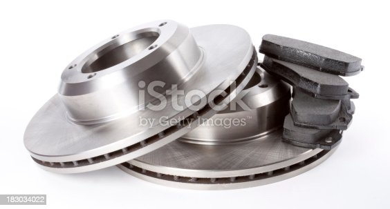 Studio shot of a full set of front brake discs and pads on a white background.View Full Category:
