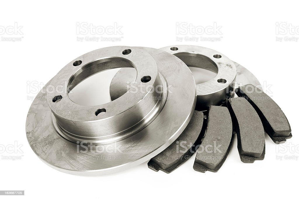 Brake pads and wheel discs on a white background stock photo