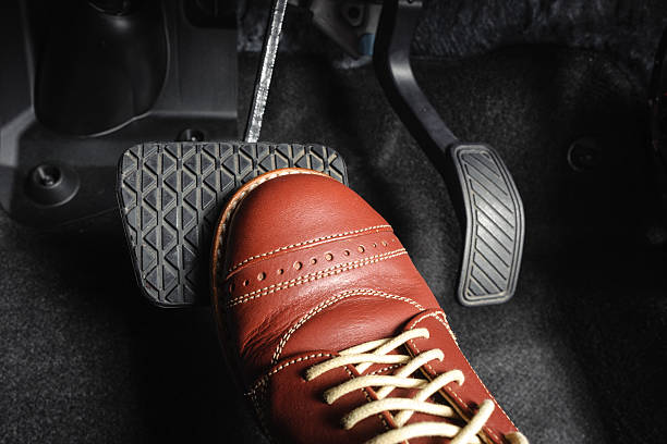 brake pedal foot pressing the brake pedal of a car vehicle clutch stock pictures, royalty-free photos & images