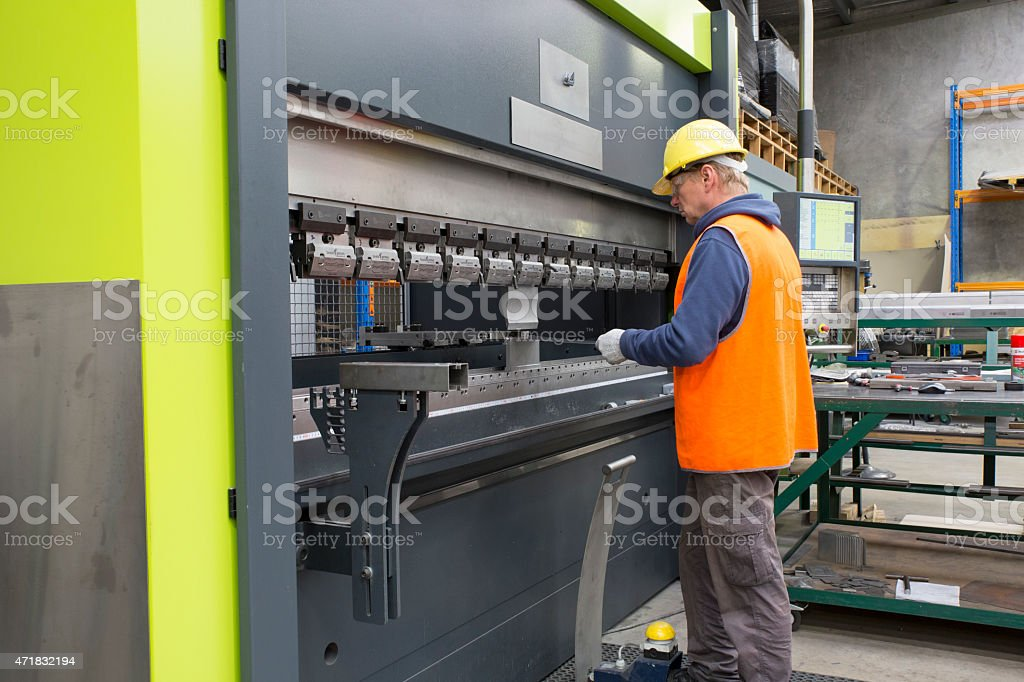 Brake press operator stock photo