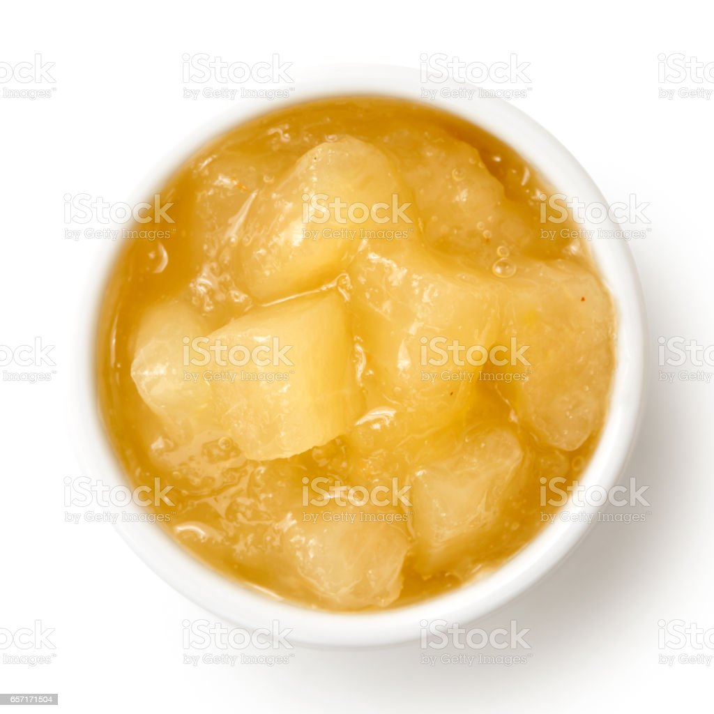 Bramley apple sauce in ceramic bowl isolated on white from above. stock photo