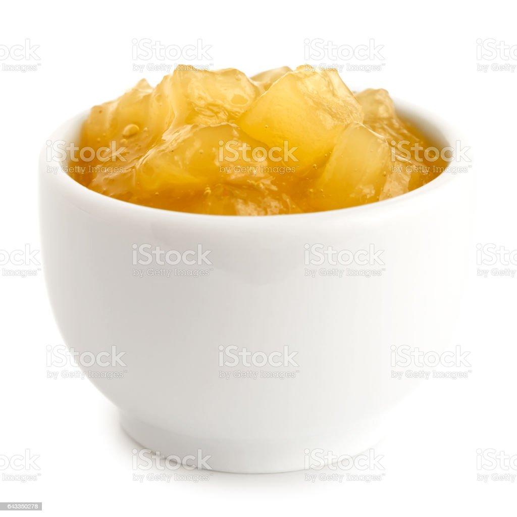 Bramley apple sauce in ceramic bowl isolated on white. stock photo