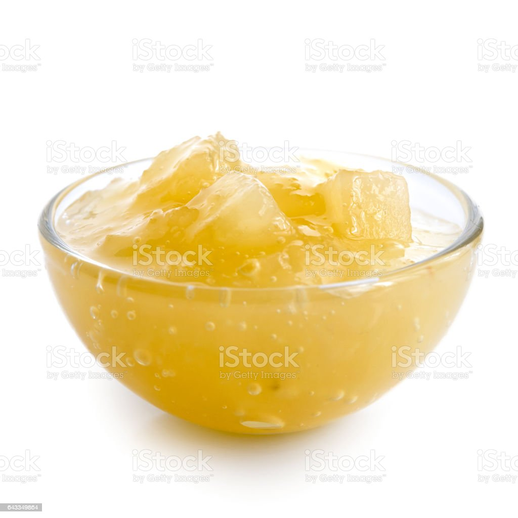 Bramley apple sauce in glass bowl isolated on white. stock photo