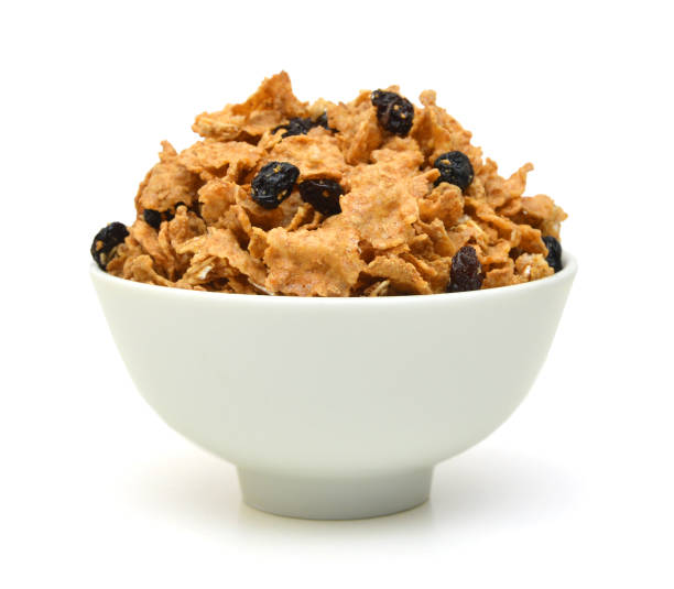bran and raisin cereal in a bowl , top view stock photo
