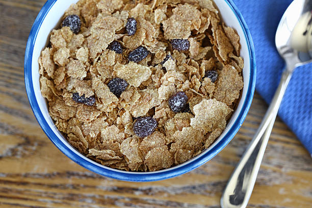 Bran and Raisin Cereal in Blue Bowl stock photo