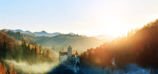 bran castle in the sunset - romania stock photos and pictures