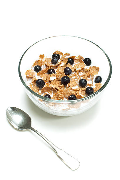 bran cereal with blueberries stock photo