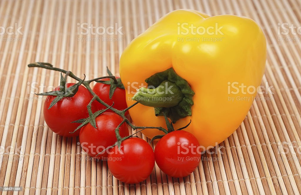 Branch a tomato and yellow pepper royalty-free stock photo
