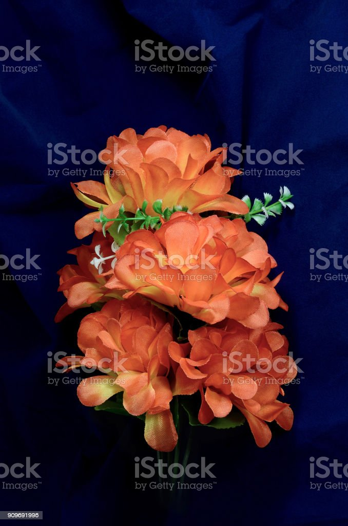 branch artificial peony blue background stock photo