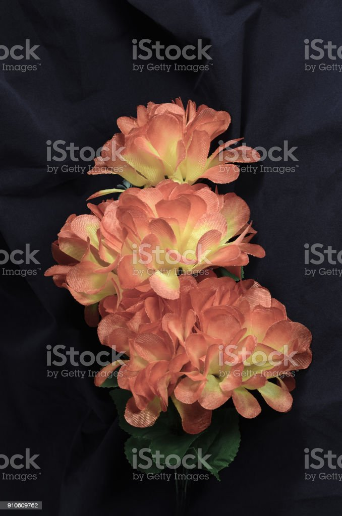 branch faded artificial peony stock photo