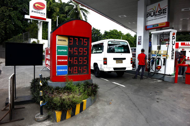 Branch of a well known gasoline refilling station along the road in Antipolo City. Antipolo City, Philippines - December 5, 2019: Branch of a well known gasoline refilling station along the road in Antipolo City. known gas stock pictures, royalty-free photos & images