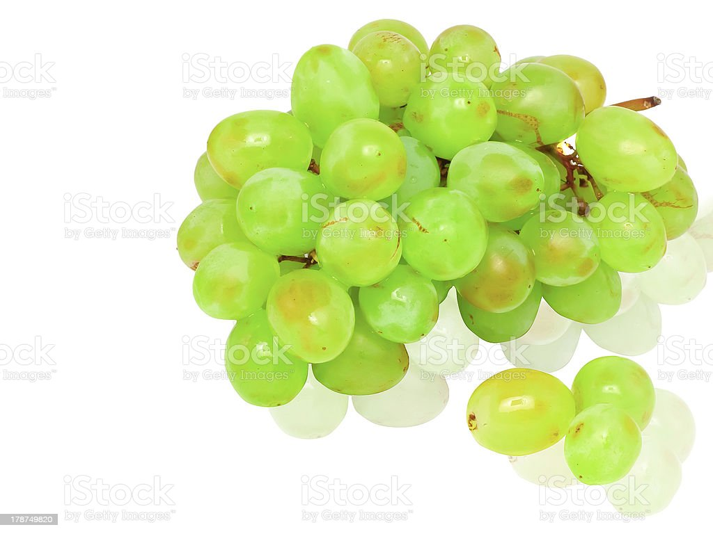 Branch of green grapes.  Isolated royalty-free stock photo