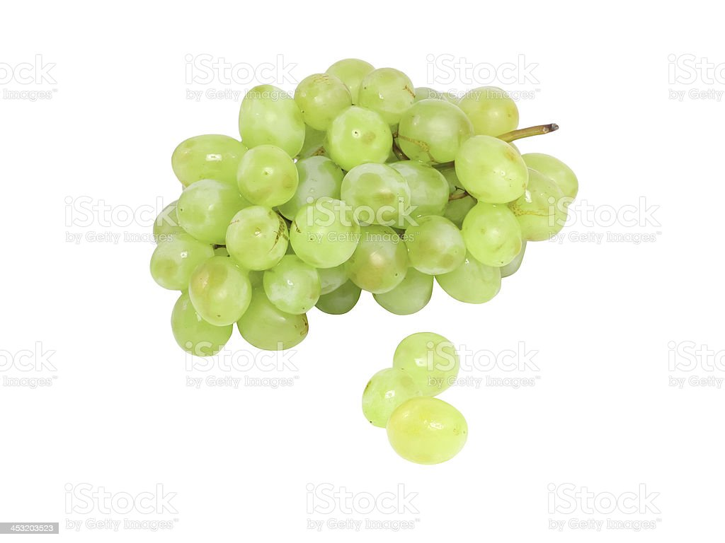 Branch of green grapes . Isolated royalty-free stock photo