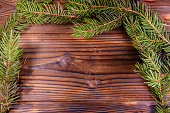 Fir tree branch on wooden table. Copy space