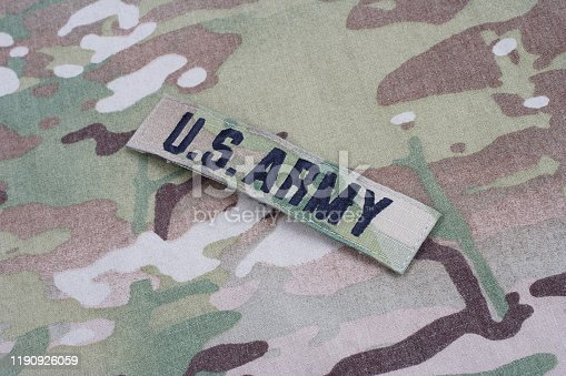 istock US ARMY branch tape on camouflage uniform 1190926059