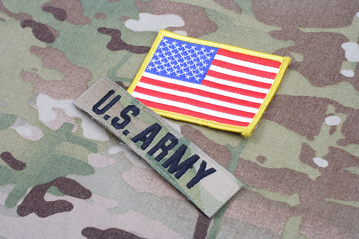 istock US ARMY branch tape with flag patch on camouflage uniform 1190926206